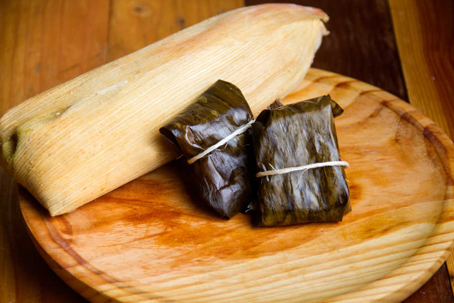 corn-husk and banana leaf wrapped Mexican corn tamales