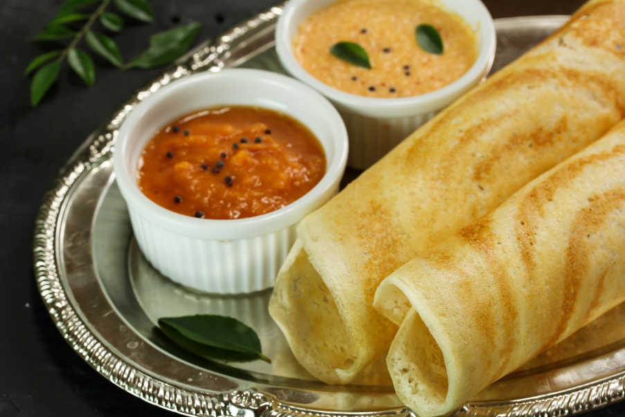 south indian dosa with coconut chutney and sambhar