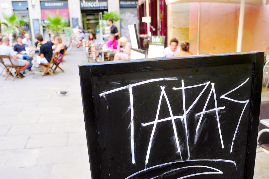 eating Spanish tapas in an outdoor cafe